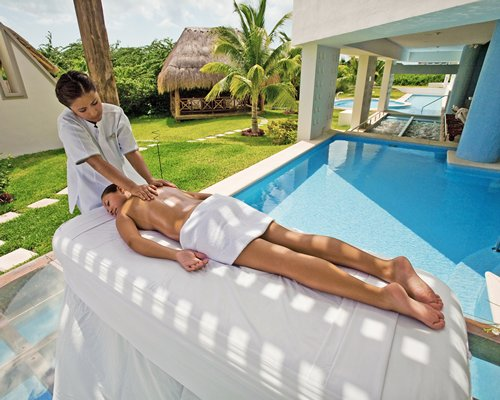 A woman at the spa alongside hot tub.