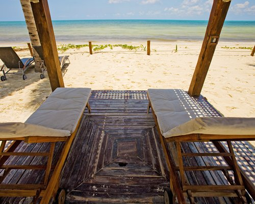 A view of chaise lounge chairs at the beach.