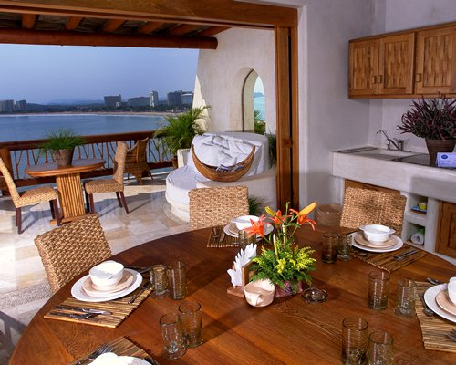 An indoor dining area with a view of the sea.