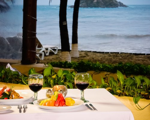 View of foods on a table with the ocean view.