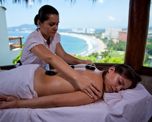 A woman having a body massage at the spa.