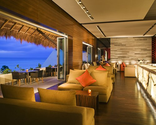 An indoor lounge area with a sea view.