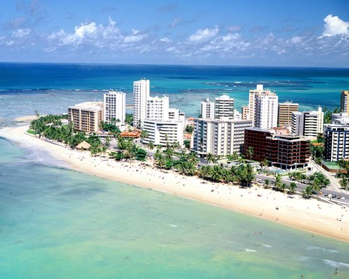 An aerial view of Maceio Mar Hotel alongside the ocean.