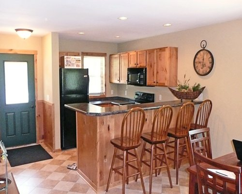 An open plan dining room and kitchen with a big breakfast bar.