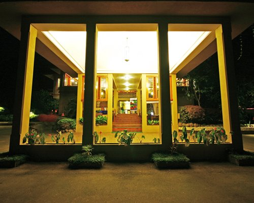 The entrance of Club Mahindra Thekkady resort at night.