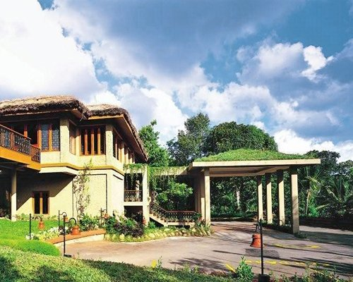 Scenic exterior view of a unit at a wooded area.