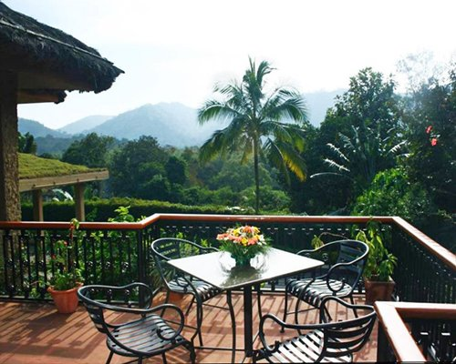 A scenic landscape from the balcony with patio furniture.