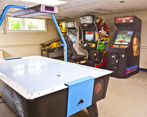 An indoor recreation room with arcades games.