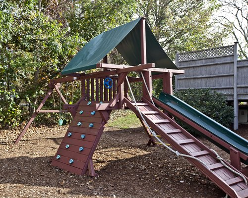 An outdoor recreational area with playscape.