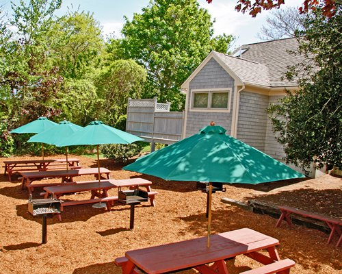 An outdoor picnic area alongside a resort unit.