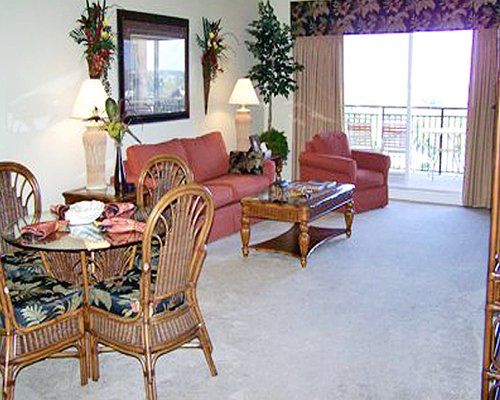 An open plan living and dining area with a balcony.