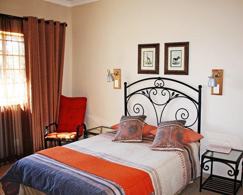 A well furnished bedroom with patio furniture.