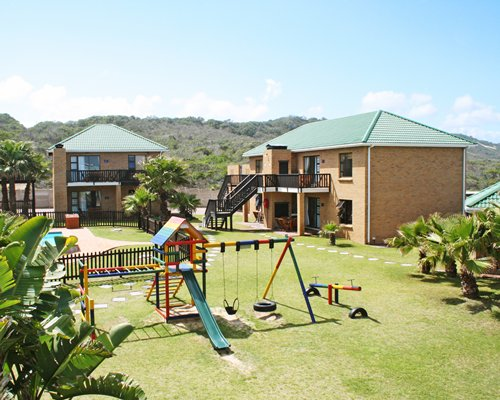 An outdoor playscape alongside the resort units.