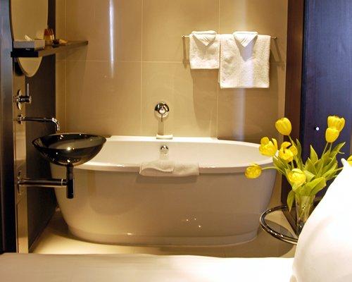A bathroom with a sink and a bathtub.