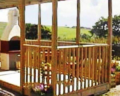 A scenic wooden pergola.