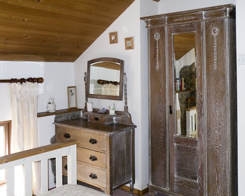 Interior view of a room with mirror and cupboard.