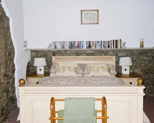 A well furnished bedroom with a double bed.