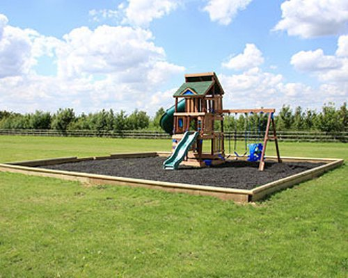 An outdoor kids playscape with a slide.