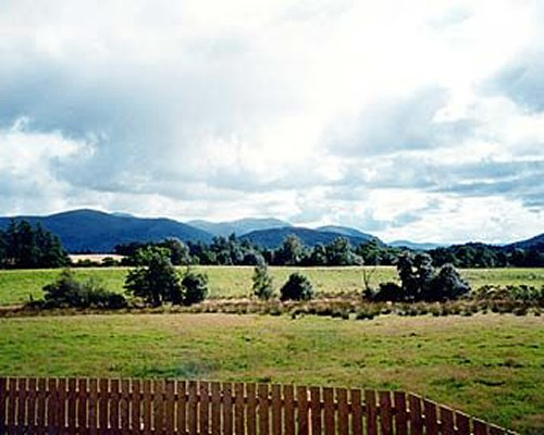 A scenic landscape and mountains from the wooden patio.