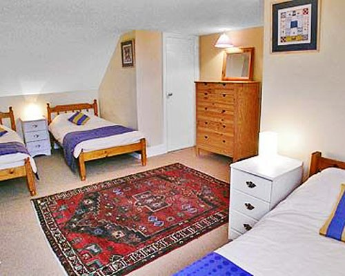 A well furnished bedroom with multiple twin beds.