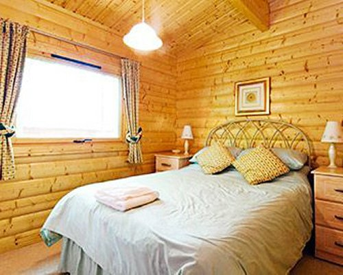 A wood paneled bedroom.