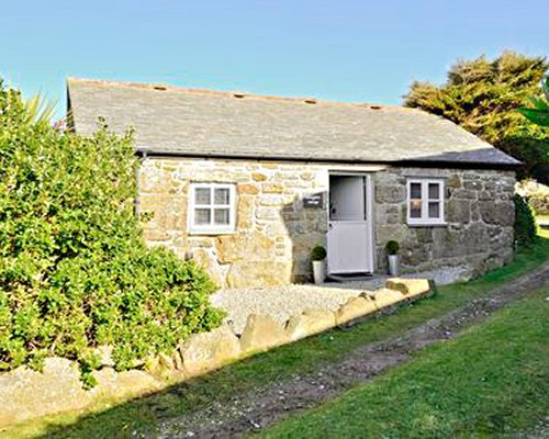 A view of stone cottage at Smugglers Cottage.