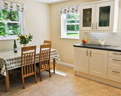 An open plan kitchen and dining room with an outside view.