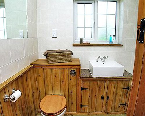 A bathroom with closed sink vanity.