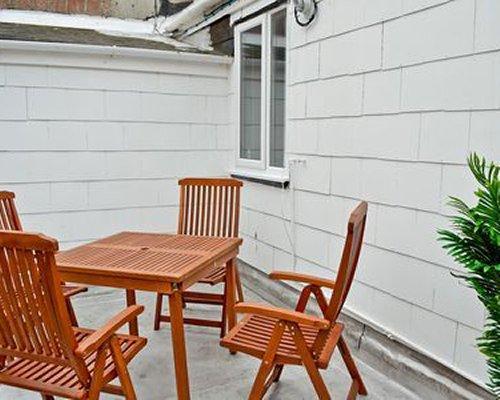 An outdoor patio alongside the resort unit.