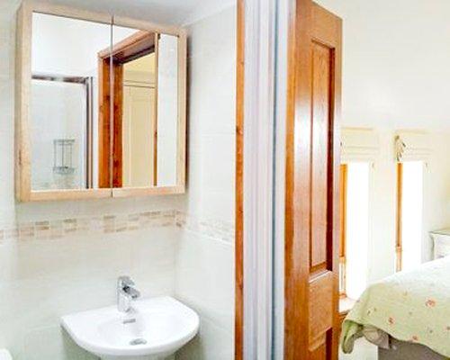 A single sink vanity alongside a bedroom.