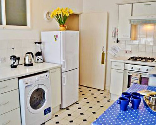 A well equipped kitchen with a refrigerator.