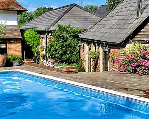 An outdoor swimming pool alongside multiple units.