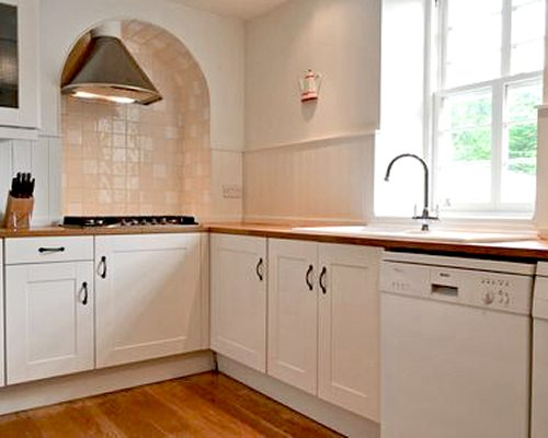 A well furnished kitchen with stove.