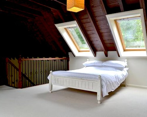 A wood paneled bedroom with an outside view.