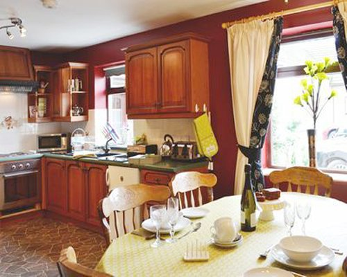 An open plan kitchen with microwave and dining area.