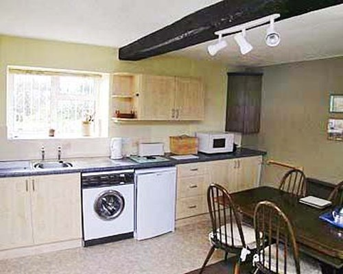 A well equipped kitchen with a dining area.