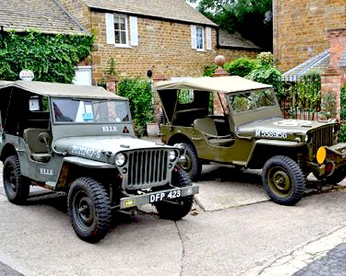 A view of two jeeps alongside resort units.
