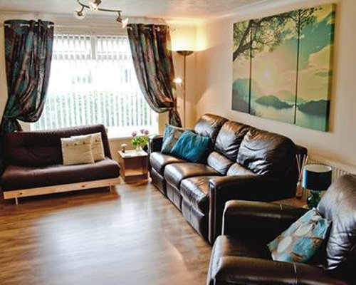 A well furnished living room with a sofa.
