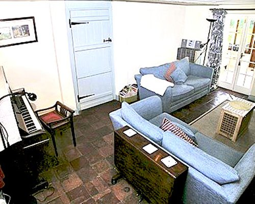 A well furnished living room with a piano.