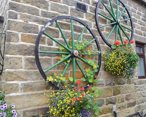Landscaping on the wall of a unit with wheels.