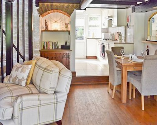 An open plan kitchen with dining area alongside living room.