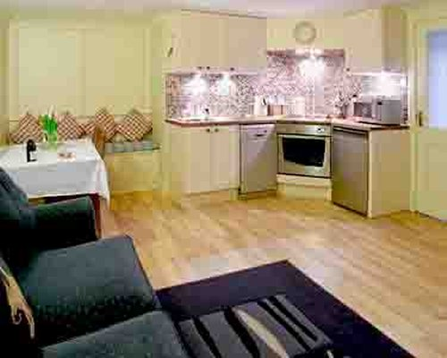 A well furnished living room with an open plan kitchen and dining area.