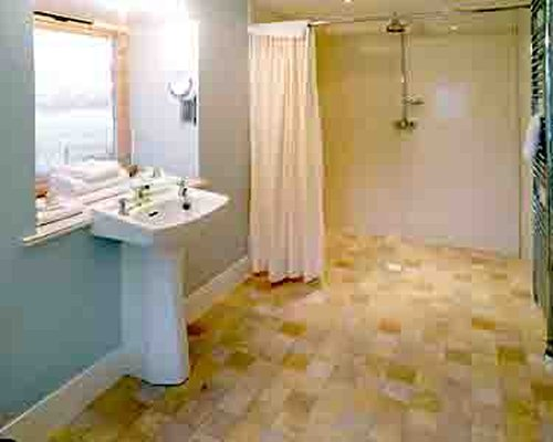A bathroom with a sink and shower.