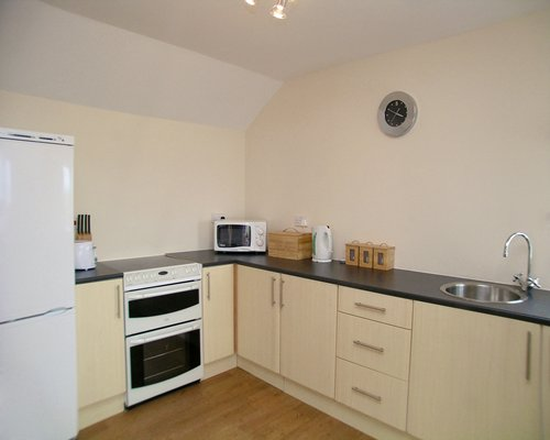 A well equipped kitchen with microwave.