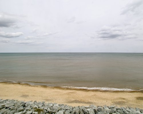 View of the beach with rocks alongside the sea.