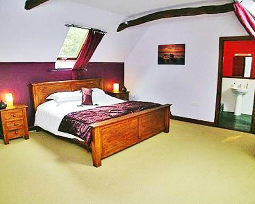 A well furnished bedroom with bathroom.