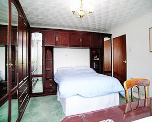 A well furnished bedroom with a dining table.