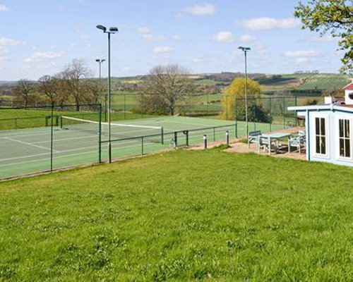 A scenic outdoor tennis court.