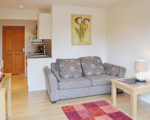 A well furnished living room with an open plan kitchen.