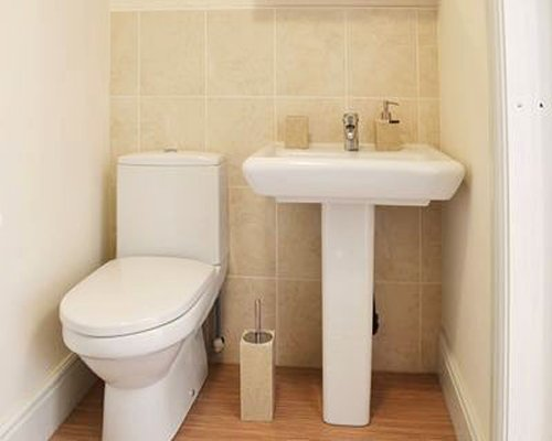 A bathroom with sink and toilet.